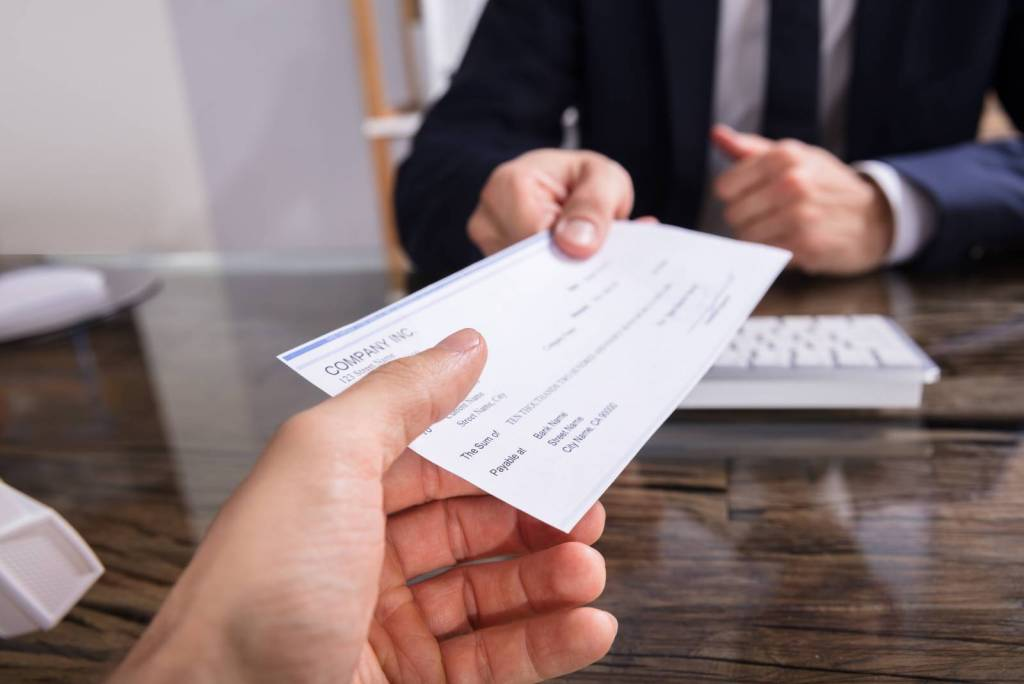 client handing check to lawyer