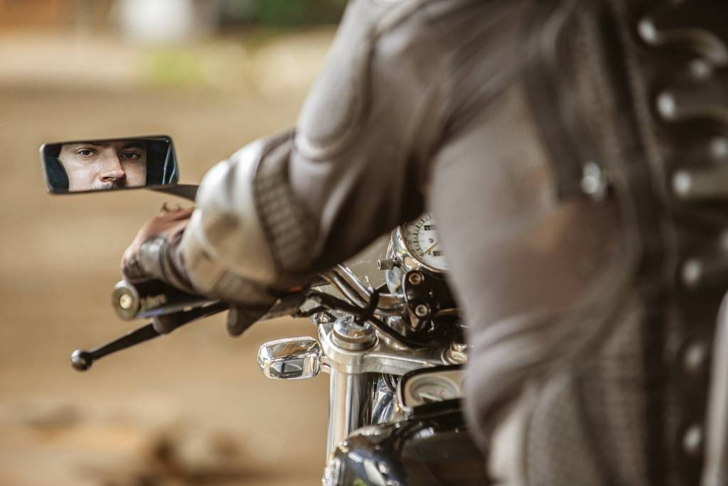 motorcycle rider looking at his side mirror